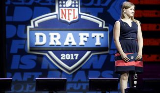 Kate Foster, 18, of Rockford, Ill., waits onstage to announce the Chicago Bears' selection in the second round of the 2017 NFL football draft, Friday, April 28, 2017, in Philadelphia. (AP Photo/Matt Rourke)