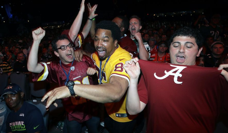 Washington Redskins' fans react after the team selected Alabama's Jonathan Allen during the first round of the 2017 NFL football draft, Thursday, April 27, 2017, in Philadelphia. (AP Photo/Julio Cortez)