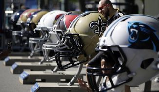 A New Orleans Saints' fan poses before the second round of the 2017 NFL football draft, Friday, April 28, 2017, in Philadelphia. (AP Photo/Matt Rourke)