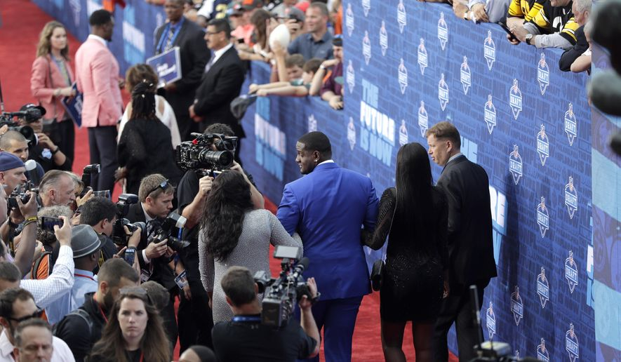 Alabama's Cam Robinson arrives for the first round of the 2017 NFL football draft, Thursday, April 27, 2017, in Philadelphia. (AP Photo/Julio Cortez)