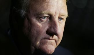 FILE - In this Sept. 28, 2015, file photo, Indiana Pacers President of Basketball Operations Larry Bird listens to a question from the news media during the team's NBA basketball media day, in Indianapolis. A person with knowledge of the situation tells The Associated Press that Larry Bird is stepping down as president of the Indiana Pacers. Kevin Pritchard is being elevated from general manager to the team's new president of basketball operations, the person told The AP. He spoke on condition of anonymity because the team has not announced the move.(AP Photo/Darron Cummings, File)