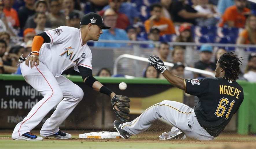 Pittsburgh Pirates' Gift Ngoepe (61) slides in safely to third for a triple as Miami Marlins third baseman Martin Prado attempts to catch the throw during the sixth inning of a baseball game, Friday, April 28, 2017, in Miami. (AP Photo/Wilfredo Lee)