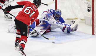 New York Rangers goalie Henrik Lundqvist makes a save on Ottawa Senators right wing Mark Stone (61) during the first period of Game 1 of an NHL hockey second-round playoff series, Thursday, April 27, 2017, in Ottawa, Ontario. (Sean Kilpatrick/The Canadian Press via AP)