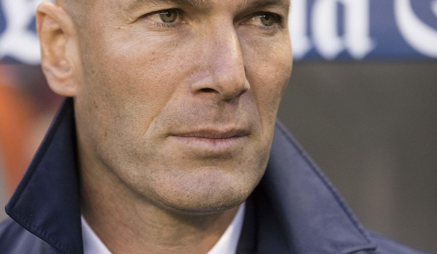 Real Madrid's coach Zinedine Zidane during a Spanish La Liga soccer match between Deportivo La Coruna and Real Madrid at the Riazor stadium in A Coruna, Spain, Wednesday April 26, 2017. (AP Photo/Lalo R. Villar)