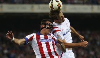 FILE - In this Saturday, Sept. 27, 2014 file photo, Atletico's Mario Mandzukic, left, in action Sevilla's Grzegorz Krychowiak, right, in between players during a Spanish La Liga soccer match between Sevilla and Atletico Madrid at the Vicente Calderon stadium in Madrid, Spain. The fight for third place has intensified again in the Spanish league, with Atletico Madrid and Sevilla looking to secure the final automatic spot for the Champions League next season (AP Photo/Andres Kudacki, File)