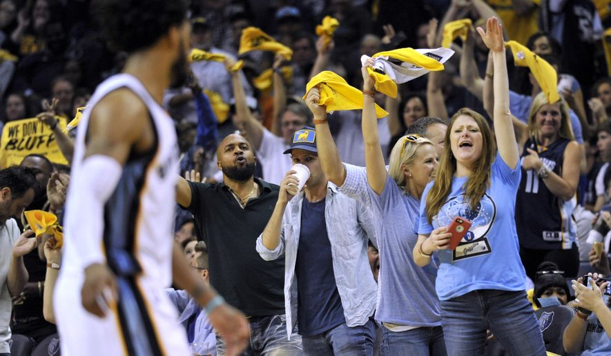 Fans cheer as Memphis Grizzlies guard Mike Conley, left, moves down the court during the second half of Game 6 of the team's NBA basketball first-round playoff series against the San Antonio Spurs, Thursday, April 27, 2017, in Memphis, Tenn. (AP Photo/Brandon Dill)