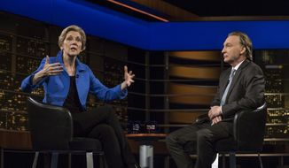 "In a photo provided by HBO, Sen. Elizabeth Warren, D-Mass., sits next to host Bill Maher on HBO's ""Real Time with Bill Maher"" on Friday, April 28, 2017, in Los Angeles. (Janet Van Ham/HBO via AP)"