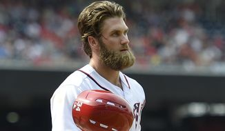 Washington Nationals' Bryce Harper reacts after striking out during the seventh inning of a baseball game against the New York Mets, Saturday, April 29, 2017, in Washington. (AP Photo/Nick Wass)