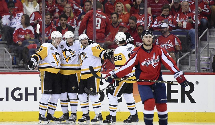 Pittsburgh Penguins center Matt Cullen (7) celebrates his goal with Olli Maatta (3), of Finland, Tom Kuhnhackl (34), of Germany, and Ron Hainsey (65) as Washington Capitals defenseman Kevin Shattenkirk (22) skates away during the second period of Game 2 in an NHL hockey Stanley Cup second-round playoff series, Saturday, April 29, 2017, in Washington. (AP Photo/Nick Wass)