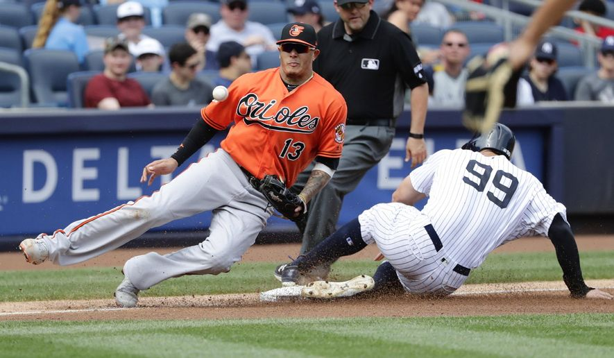 New York Yankees' Aaron Judge (99) steals third base as Baltimore Orioles' Manny Machado (13) fields the throw during the fourth inning of a baseball game Saturday, April 29, 2017, in New York. (AP Photo/Frank Franklin II)