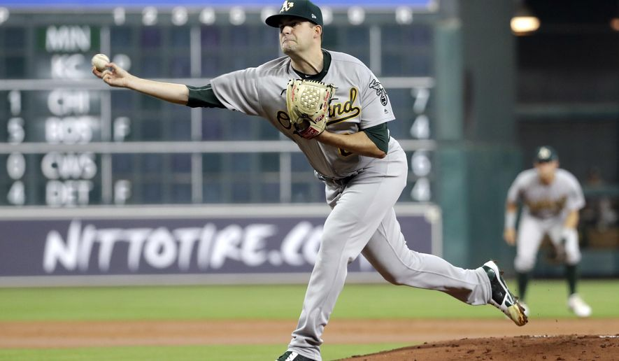 Oakland Athletics starting pitcher Andrew Triggs throws against the Houston Astros during the first inning of a baseball game Saturday, April 29, 2017, in Houston. (AP Photo/David J. Phillip)