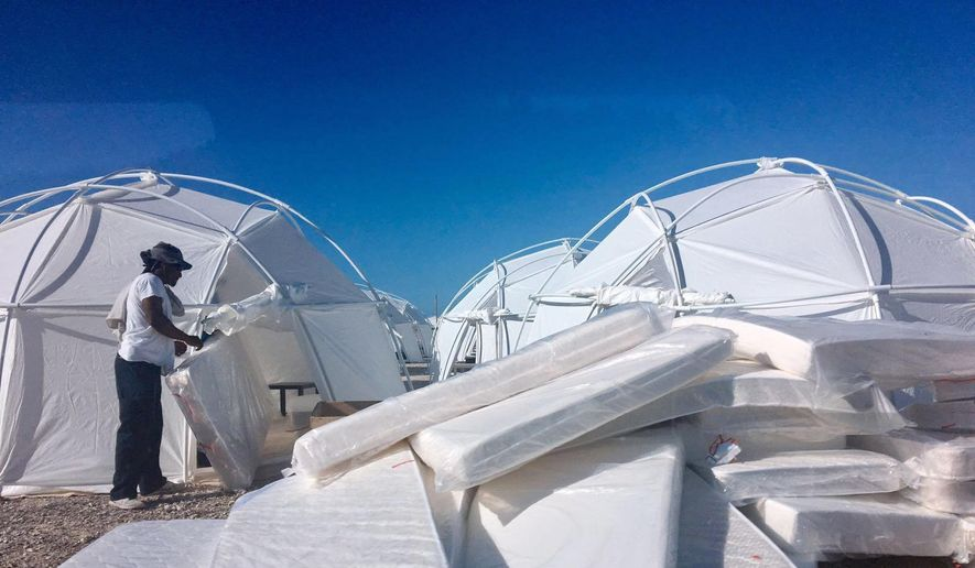 "This photo provided by Jake Strang shows mattress and tents set up for attendees of the Fyre Festival, Friday, April 28, 2017, in the Exuma islands, Bahamas. Organizers of the much-hyped music festival in the Bahamas canceled the weekend event at the last minute Friday after many people had already arrived and spent thousands of dollars on tickets and travel. A statement cited ""circumstances out of our control,"" for their inability to prepare the ""physical infrastructure"" for the event in the largely undeveloped Exumas. (Jake Strang via AP)"