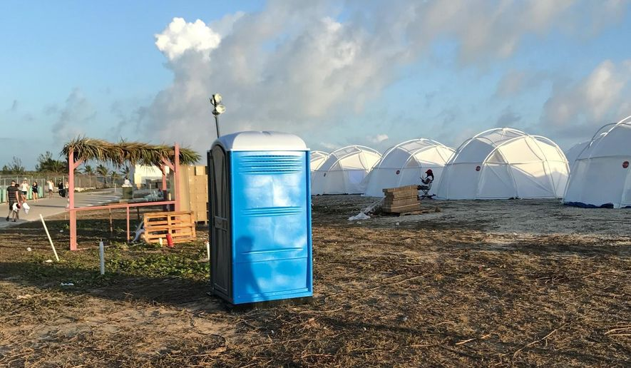 This photo provided by Jake Strang shows tents and a portable toilet set up for attendees for the Fyre Festival, Friday, April 28, 2017 in the Exuma islands, Bahamas. (Jake Strang via AP)