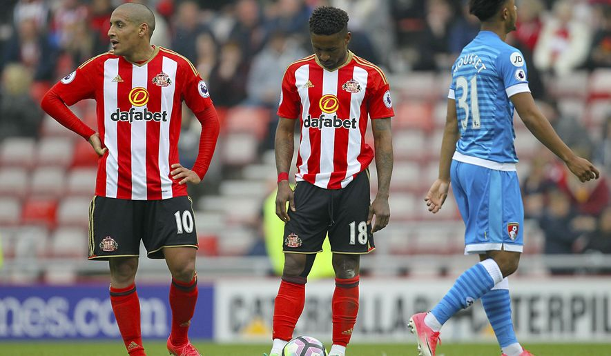 Sunderland's Wahbi Khazri, left, and Sunderland's Jermain Defoe show their dejection as their side concede during their English Premier League soccer match against AFC Bournemouth at the Stadium of Light, Sunderland, England, Saturday, April 29, 2017. (Richard Sellers/PA via AP)