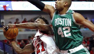 Chicago Bulls' Jimmy Butler, left, drives to the basket against Boston Celtics' Al Horford during the first half in Game 6 of an NBA basketball first-round playoff series, Friday, April. 28, 2017, in Chicago. (AP Photo/Nam Y. Huh)