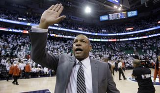 Los Angeles Clippers coach Doc Rivers celebrates as he runs off the court following Game 6 of the team's NBA basketball first-round playoff series against the Utah Jazz on Friday, April 28, 2017, in Salt Lake City. The Clippers won 98-93, forcing a seventh game. (AP Photo/Rick Bowmer)