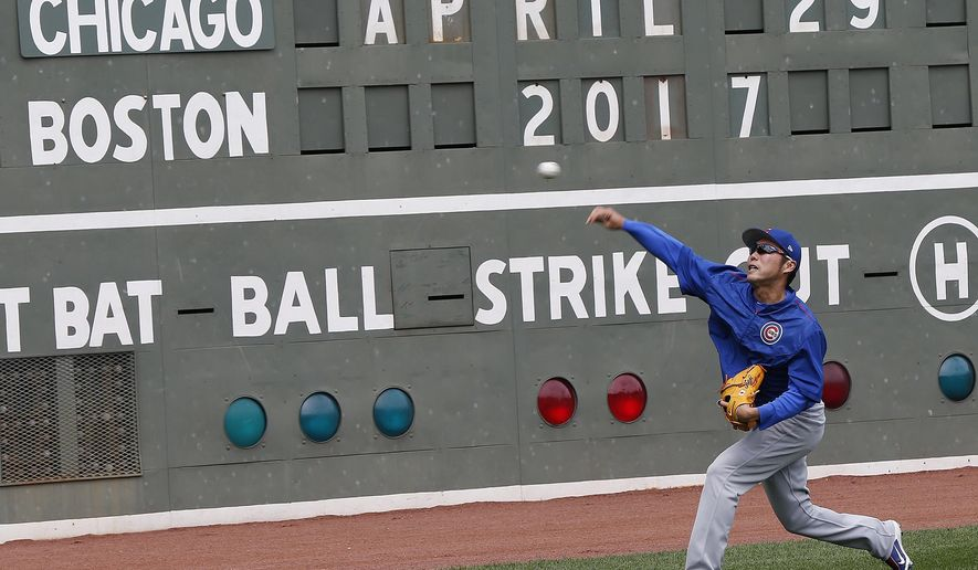 Chicago Cubs' Koji Uehara warms up before a baseball game against the Boston Red Sox, Saturday, April 29, 2017, in Boston. (AP Photo/Michael Dwyer)