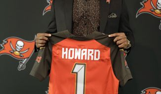 Tampa Bay Buccaneers 2017 first round draft pick O.J. Howard holds up a jersey during an NFL football news conference Friday, April 28, 2017, in Tampa, Fla. Howard was a tight end at Alabama. (AP Photo/Chris O'Meara)