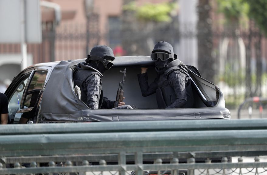 Security forces patrol the area where Pope Francis will celebrate Mass for Egypt's tiny Catholic community, in Cairo, Saturday, April 29, 2017. Pope Francis came to Egypt on Friday for a historic visit to the Arab and Muslim majority nation aimed at presenting a united Christian-Muslim front to repudiate violence committed in God's name. (AP Photo/Gregorio Borgia)