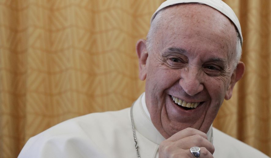 Pope Francis smiles as he talks to journalists during a press conference he held on his return flight from Cairo to Rome, Saturday, April 29, 2017. Pope Francis traveled to Egypt on Friday for a historic visit to the Arab and Muslim majority nation aimed at presenting a united Christian-Muslim front to repudiate violence committed in God's name. (AP Photo/Gregorio Borgia)