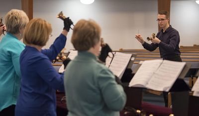 ADVANCE FOR WEEKEND EDITIONS, APRIL 29-30 - In this Thursday, April 13, 2017 photo, director of music Matt Compton leads the handbell choir at Salmon Creek United Methodist Church in Vancouver, Wash. (Amanda Cowan/The Columbian via AP)