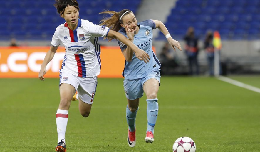 Lyon's Saki Kumagai, left, challenges for the ball with Manchester City's Kosovare Asllani, right, during their Women's Champions League semifinal soccer match in Decines, near Lyon, central France, Saturday, April 29, 2017. (AP Photo/Laurent Cipriani)