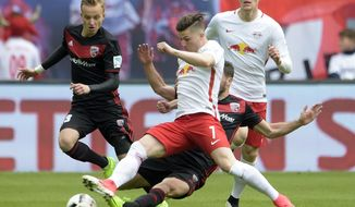 Leipzig's Marcel Sabitzer, front, challenges for the ball during the German first division Bundesliga soccer match between RB Leipzig and FC Ingolstadt 04 in Leipzig, Germany, Saturday, April 29, 2017. (AP Photo/Jens Meyer)