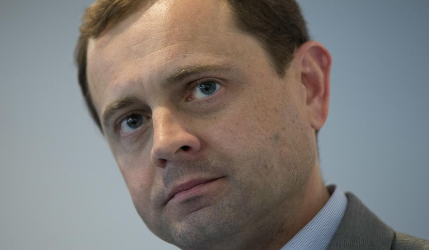 In this Wednesday, March 15, 2017, photo Democratic gubernatorial candidate, former Congressman Tom Perriello listens during a town hall in Richmond, Va. Perriello is running against Lt. Gov. Ralph Northam in in the June 13 primary. (AP Photo/Steve Helber)
