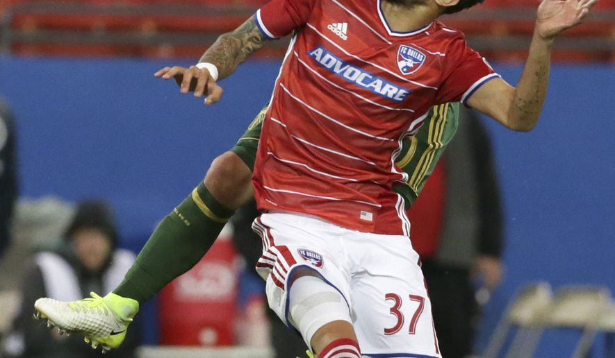 Portland Timbers midfielder David Guzman, left, and FC Dallas forward Maximiliano Urruti (37) vie for control of the ball during the first half of an MLS soccer match in Frisco, Texas, Saturday, April 29, 2017. (AP Photo/LM Otero)