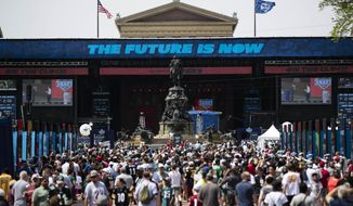 Fans gather for the 2017 NFL football draft, Saturday, April 29, 2017, on the steps of the Philadelphia Museum of Art in Philadelphia. (AP Photo/Matt Rourke)