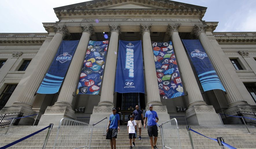 Banners hand from the Franklin Institute during the 2017 NFL football draft, Saturday, April 29, 2017, in Philadelphia. (AP Photo/Matt Rourke)