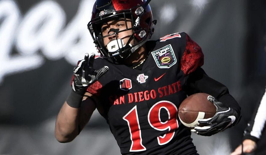 FILE - In this Dec. 17, 2016, file photo, San Diego State running back Donnel Pumphrey runs against Houston during the first half of the Las Vegas Bowl NCAA college football game in Las Vegas. Pumphrey was selected by the Philadelphia Eagles in the fourth round, 132nd overall, of the NFL draft on Saturday, April 29, 2017.  (AP Photo/David Becker, File)