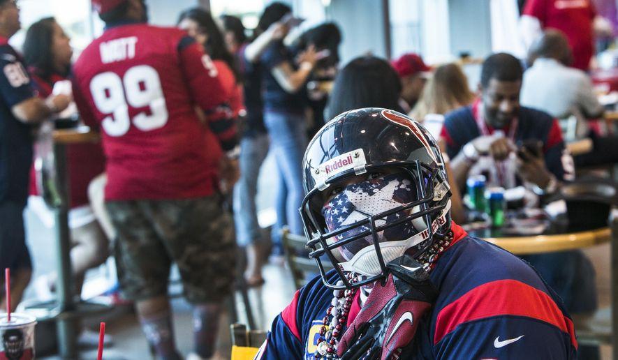 Houston Texans fan Nicolas Garcia watches the NFL football draft during the Texans' draft party at NRG Stadium on Thursday, April 27, 2017, in Houston. (Brett Coomer/Houston Chronicle via AP)