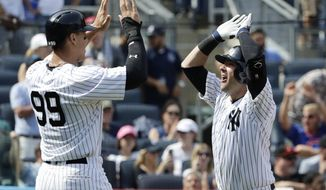 New York Yankees' Austin Romine, right, celebrates with teammate Aaron Judge, left, after Romine hit a  2-run home run during the sixth inning of a baseball game against the Baltimore Orioles, Saturday, April 29, 2017, in New York. (AP Photo/Frank Franklin II)