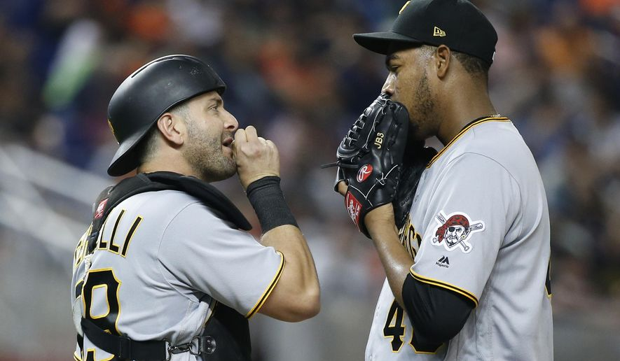 Pittsburgh Pirates starting pitcher Ivan Nova, right, and catcher Francisco Cervelli talk during the fifth inning of the team's baseball game against the Miami Marlins, Saturday, April 29, 2017, in Miami. (AP Photo/Wilfredo Lee)
