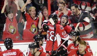 Ottawa Senators center Jean-Gabriel Pageau (44) celebrates his game-winning goal with left wing Mike Hoffman (68) during the second overtime of Game 2 against the New York Rangers in an NHL hockey Stanley Cup second-round playoff series Saturday, April 29, 2017, in Ottawa, Ontario. The Senators won 6-5. (Adrian Wyld/The Canadian Press via AP)