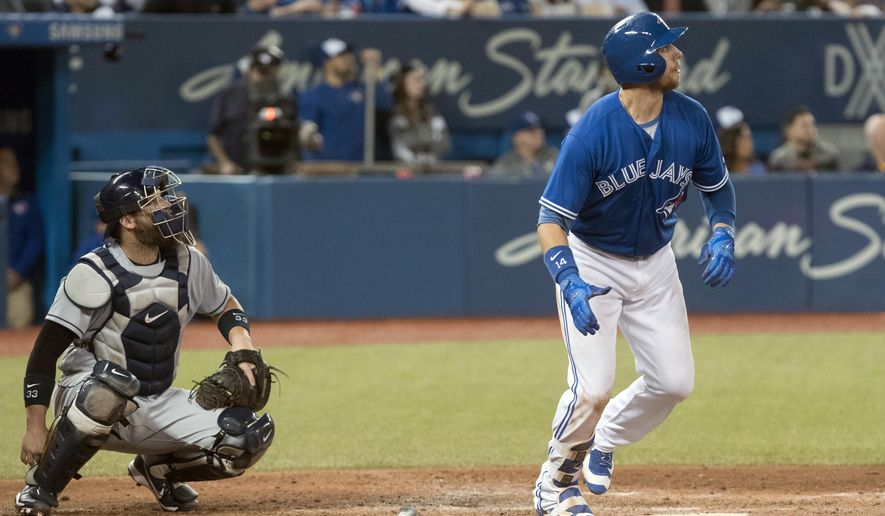 Toronto Blue Jays' Justin Smoak hits a  2-run home run against the Tampa Bay Rays in the sixth inning  in Toronto on Saturday April 29, 2017. (Fred Thornhill/The Canadian Press via AP)