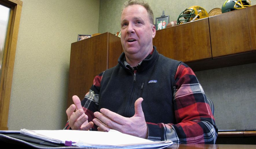 In this March 24, 2017 photo, Fargo City Commissioner Dave Piepkorn talks about the city's refugee resettlement program during an interview at his lawn care business in Fargo, N.D. A group of refugee supporters are collecting signatures to try and recall Piepkorn because they say his stance against the program does not support diversity. Piepkorn says he is merely asking how much taxpayer money is being spent on refugees. (AP Photo/Dave Kolpack)