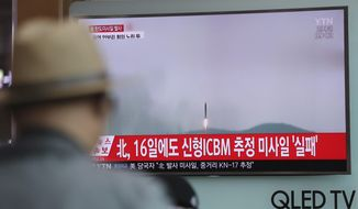"""A man watches a TV news program reporting about North Korea's missile firing with a file footage, at Seoul Train Station in Seoul, South Korea, Saturday, April 29, 2017. A North Korean mid-range ballistic missile apparently failed shortly after launch Saturday, South Korea and the United States said, the second such test-fire flop in recent weeks but a clear message of defiance as a U.S. supercarrier conducts drills in nearby waters. The letters on top left, reading """"North Korea fired a ballistic missile."""" (AP Photo/Lee Jin-man)"""