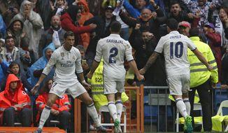 Real Madrid's Cristiano Ronaldo, left, celebrates after scoring the opening goal against Valencia during the Spanish La Liga soccer match between Real Madrid and Valencia at the Santiago Bernabeu stadium in Madrid, Saturday, April 29, 2017. (AP Photo/Francisco Seco)
