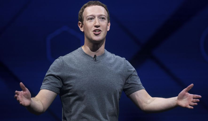 FILE - In this April 18, 2017 file photo, Facebook CEO Mark Zuckerberg speaks at his company's annual F8 developer conference in San Jose, Calif.  An Ohio family says they learned just 20 minutes before dinner this week that a planned mystery guest would be Zuckerberg. He dined Friday, April 29  with the Moore family in Newton Falls, Ohio, about 55 miles southeast of Cleveland.  Zuckerberg announced on Facebook in January that he was challenging himself to visit people in all 50 states. (AP Photo/Noah Berger)