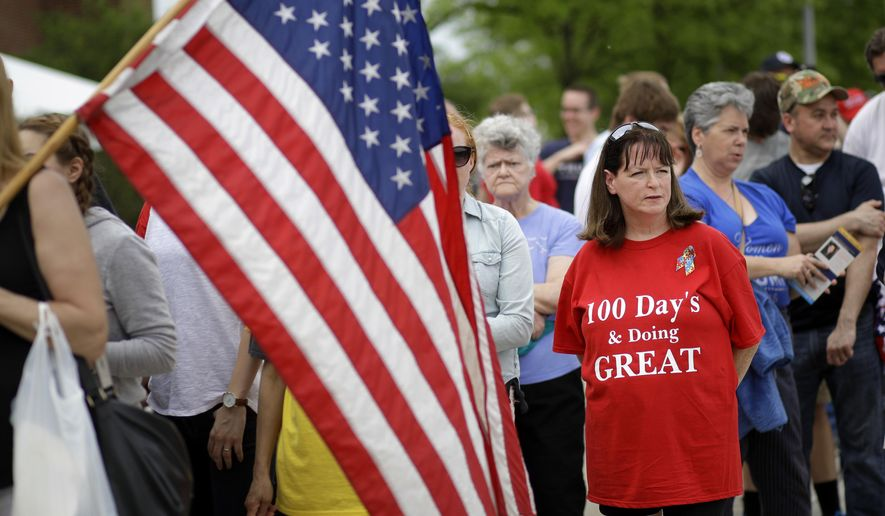 Nancy Rewick wears a homemade shirt in support of President Donald Trump as she waits in line to attend a rally featuring Trump in Harrisburg, Pa., Saturday, April 29, 2017. (AP Photo/Patrick Semansky)