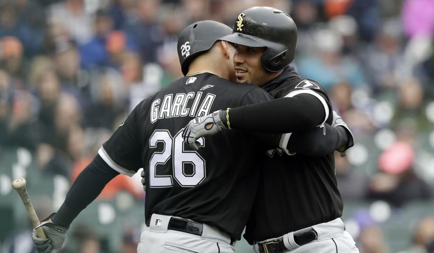 Chicago White Sox's Jose Abreu, right, is hugged by Avisail Garcia (26) after a solo home run during the third inning of a baseball game against the Detroit Tigers, Saturday, April 29, 2017, in Detroit. (AP Photo/Carlos Osorio)