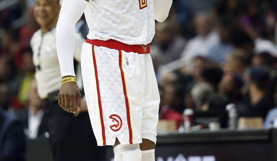 Atlanta Hawks center Dwight Howard (8) walks off the court in the second half of Game 6 of a first-round NBA playoff basketball series against the Washington Wizards, Friday, April 28, 2017, in Atlanta. (AP Photo/John Bazemore)