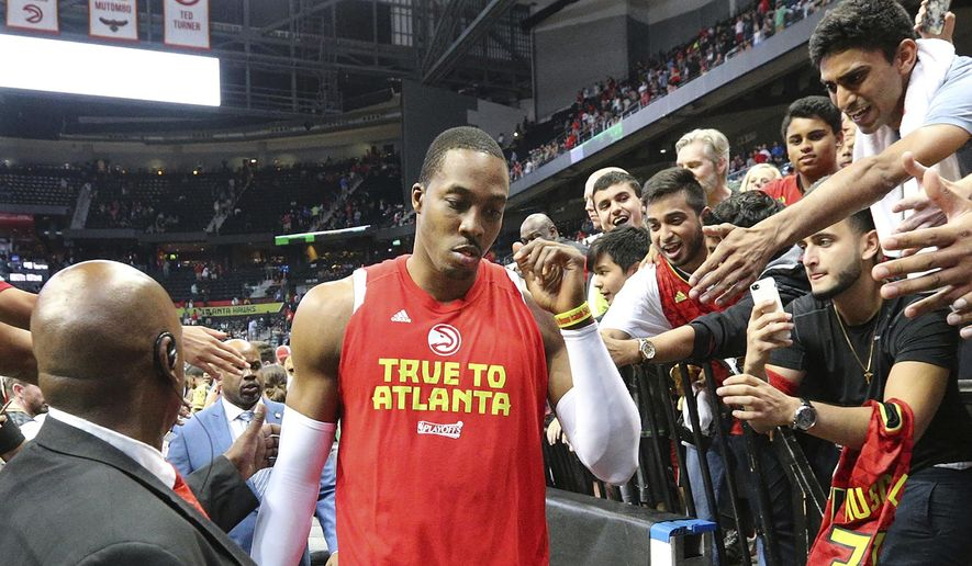 Atlanta Hawks Dwight Howard, who did not play in the fourth quarter, leaves the court after his team fell to the Washington Wizards in Game 6 of a first-round NBA basketball playoff series on Friday, April 28, 2017, in Atlanta. (Curtis Compton/Atlanta Journal-Constitution via AP) **FILE**