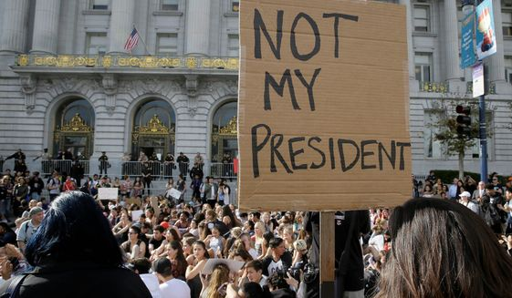 High school students protest in opposition of Donald Trump's presidential election victory in front of City Hall in San Francisco, Thursday, Nov. 10, 2016. (AP Photo/Eric Risberg) (credit)