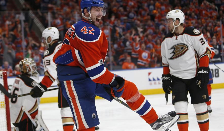 Edmonton Oilers left wing Anton Slepyshev (42) celebrates his goal against the Anaheim Ducks during the first period in Game 3 of a second-round NHL hockey Stanley Cup playoff series in Edmonton, Alberta, Sunday, April 30, 2017. (Jeff McIntosh/The Canadian Press via AP)
