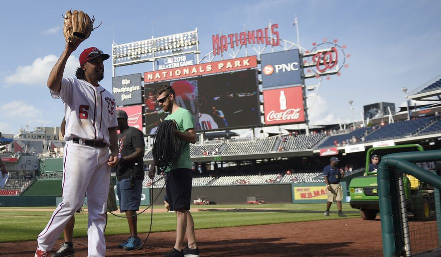 Washington Nationals' Anthony Rendon walks off the field after a baseball game against the New York Mets, Sunday, April 30, 2017, in Washington. The Nationals won 23-5. (AP Photo/Nick Wass)