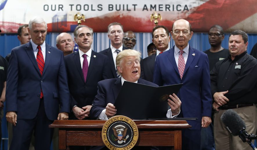President Trump signed the Executive Order on the Establishment of Office of Trade and Manufacturing Policy at The AMES Cos. Inc. in Harrisburg, Pennsylvania, in April. He requires every new regulation to be accompanied by the elimination of two regulations, resulting in a net reduction in regulations for the first time in U.S. history. (Associated Press/File)