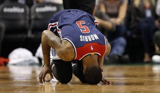Washington Wizards' Markieff Morris puts his head on the court after being injured during the second quarter of a second-round NBA playoff series basketball game against the Boston Celtics, Sunday, April, 30, 2017, in Boston. (AP Photo/Michael Dwyer)
